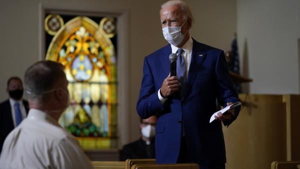 Joe Biden speaks as he meets with members of the community at Grace Lutheran Church in Kenosha, Wis.