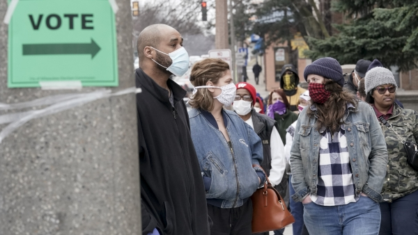 Voters wearing masks