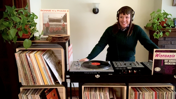 Stacy Harbaugh poses with vinyl polka records