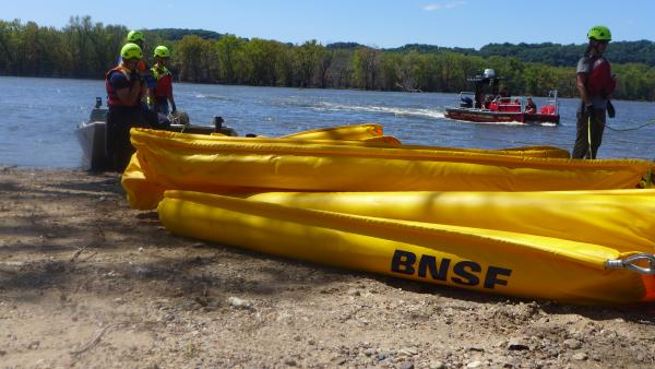 First responders deploy boom on Mississippi river