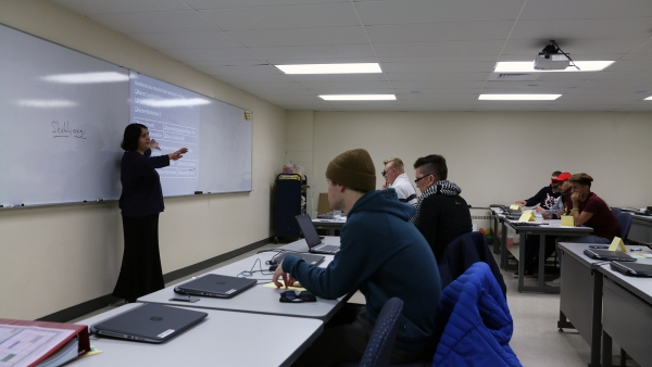 Students and professor in math class