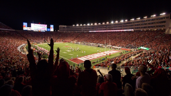 Fans celebrate after Wisconsin scored against Utah State during a football game in Madison, Wis.