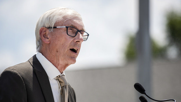 The sky can be seen behind Tony Evers as he speaks during a press conference.