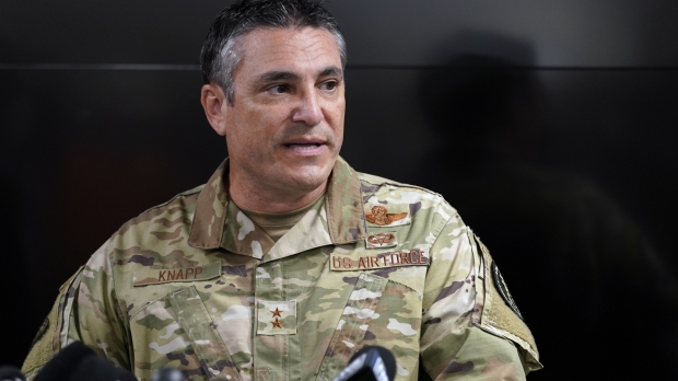 Maj. Gen. Paul Knapp of the Wisconsin National Guard speaks at a news conference.