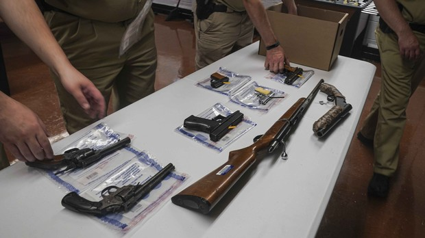 officers from the NYPD firearm and tactical unit pack collection of illegal guns after a gun buyback event