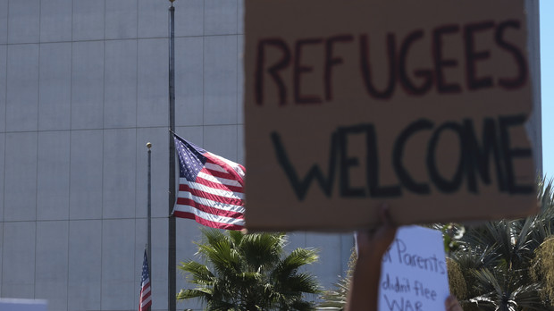 """Demonstration to call for an """"Open Door"""" policy for Afghanistan refugees."""