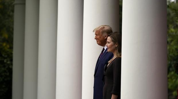 President Donald Trump walks with Judge Amy Coney Barrett