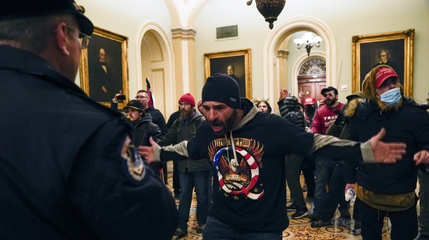 Protesters gesture to U.S. Capitol Police in the hallway outside of the Senate chamber inside the Capitol on Wednesday.