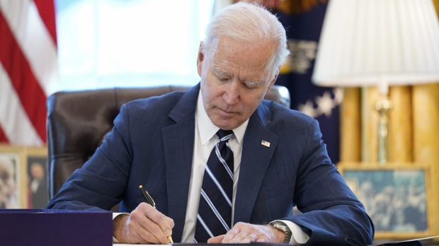 President Joe Biden signs the American Rescue Plan