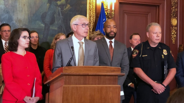 Evers speaking at press conference