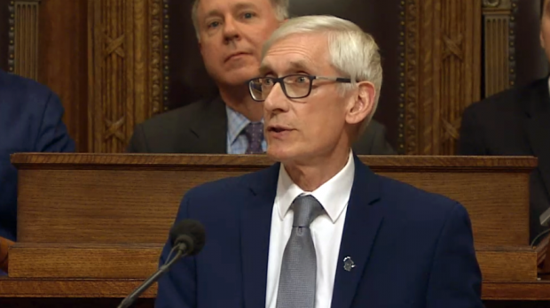 Tony Evers speaking at podium