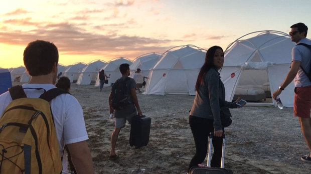 fyre festival attendees on the beach
