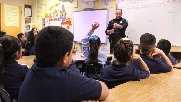 Milwaukee Officer in classroom