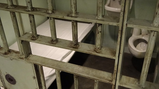 looking into prison cell through bars