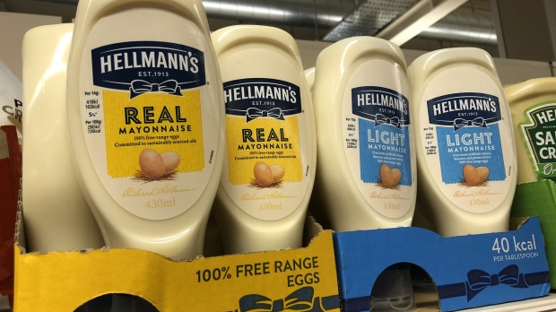 A close-up of mayo products on a grocery store shelf.