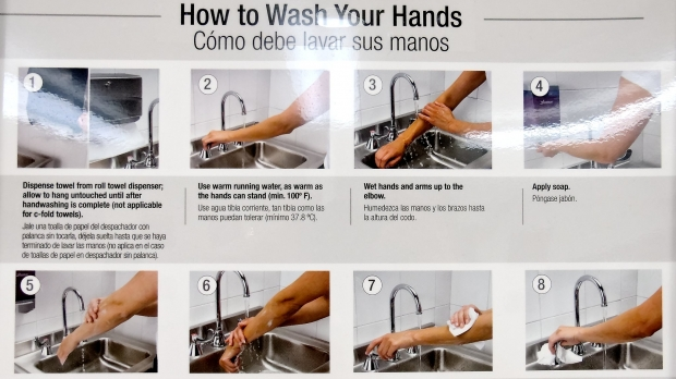 A poster demonstrates hand washing