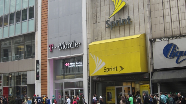 A T-Mobile and Sprint storefront side by side.