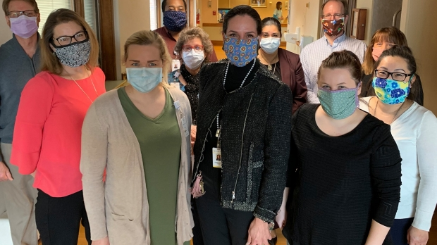 Workers at Luther Manor in Wauwatosa wearing face masks