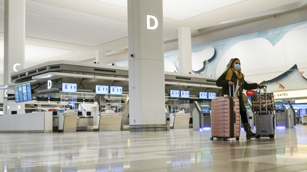 A traveler walks through Terminal B of LaGuardia Airport in New York.