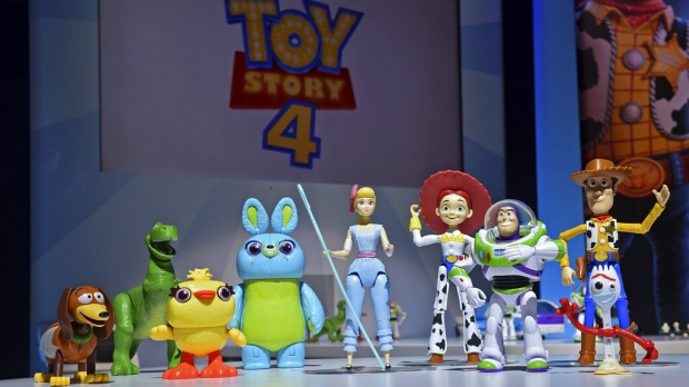The animated characters of Toy Story 4 stand in a line.