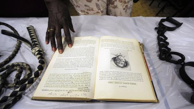 Barbara Martin looks at a display about slavery