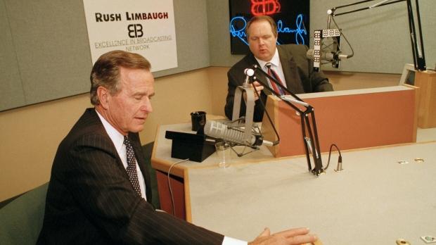 President George Bush talks with conservative radio host Rush Limbaugh