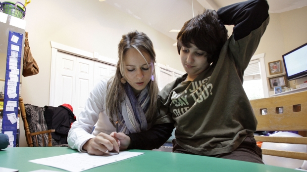 A child goes through a session of Applied Behavior Analysis therapy in their home.