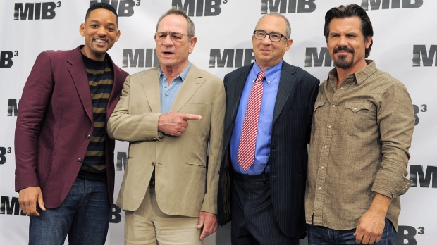 "Director Barry Sonnenfeld, second from right, poses with cast members, from left, Will Smith, Tommy Lee Jones and Josh Brolin at a photo call for the film, ""Men in Black 3,"" Thursday, May 3, 2012, in Beverly Hills, Calif."