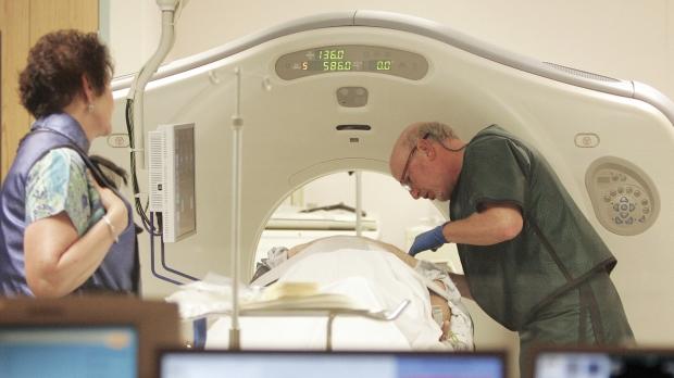 A patient prepares for a CT scan