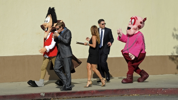 Cereal mascots Count Chocula and Frankenberry, along with theiragents and producer, walk while discussing current projects