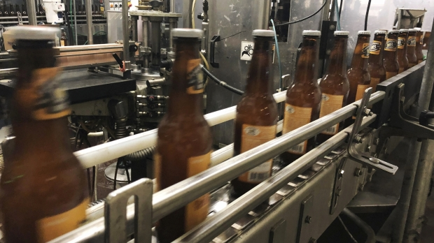 Bottles, freshly filled with beer, move on a belt at Lakefront Brewery in Milwaukee
