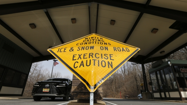 A sign warns of icy road conditions