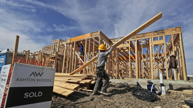 Construction workers build housing