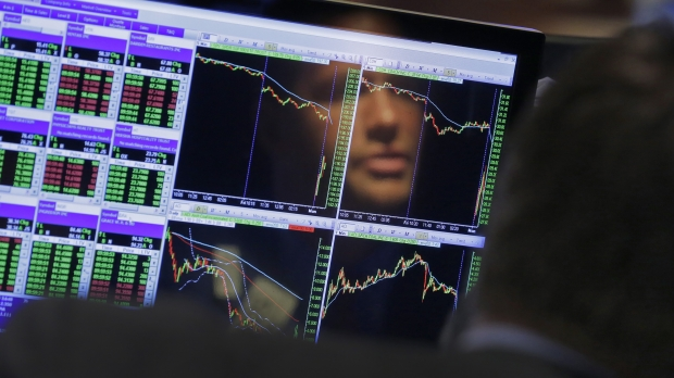 Trader looks at screen at New York Stock Exchange