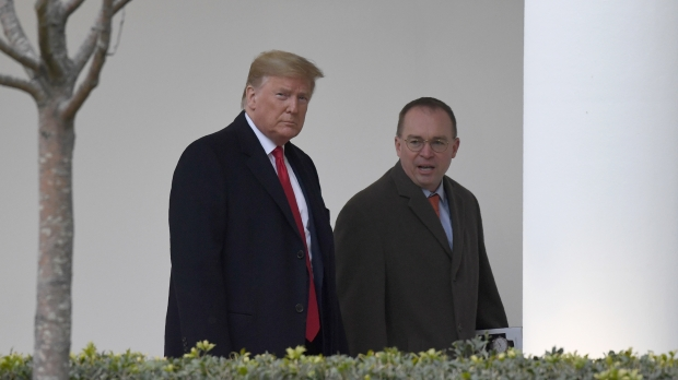 President Trump walks with Mick Mulvaney outside White House