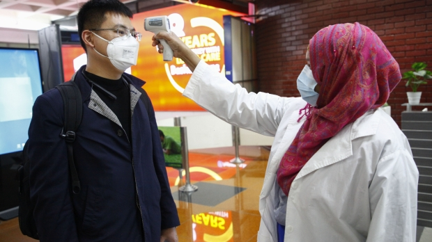 A passenger from Beijing is screened as part of measures to prevent coronavirus infection at Hazrat Shahjalal International airport in Dhaka, Bangladesh.