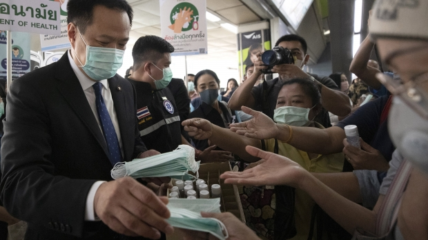 Thai official distributes face masks at skytrain station in Bangkok