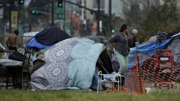 A person is seen at a homeless encampment amid the COVID-19 outbreak