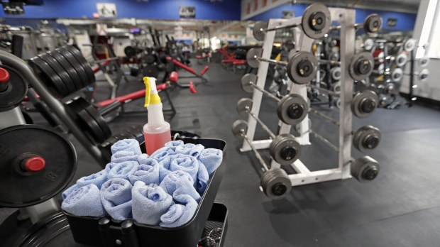 A Florida gym has towels and sanitizing spray readily available to visitors.