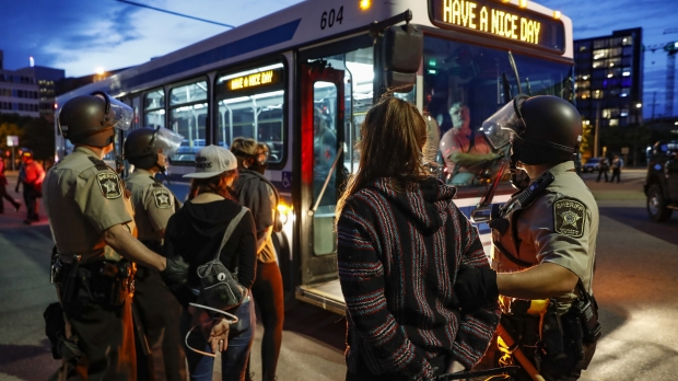 Arrested protesters loaded onto a bus in Minneapolis