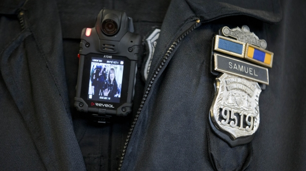 A police officer with a body-worn camera.