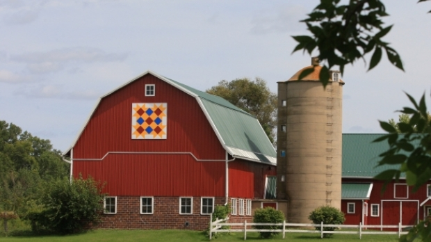 A colorful barn quilt square stands out on a farm in Shawano County, Wis.