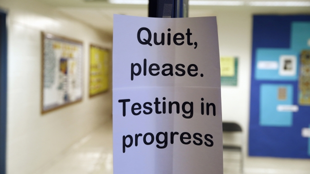 A sign is seen at the entrance to a hall for a college test preparation class in Bethesda, Md.