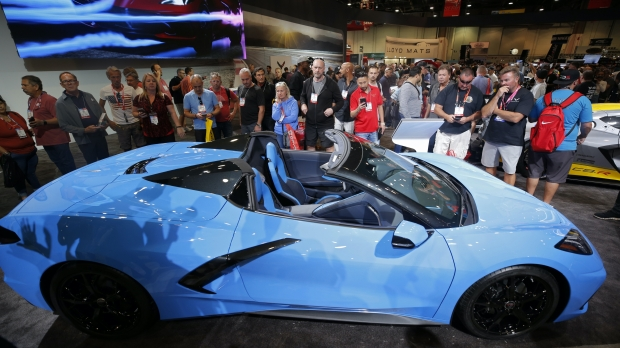People look at a 2020 Chevrolet Corvette Stingray Convertible.