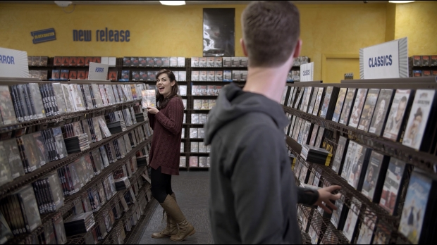 Couple in Blockbuster Video store picking movies