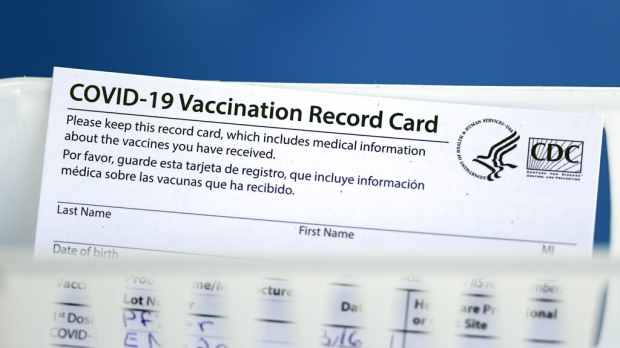 A COVID-19 vaccination record card
