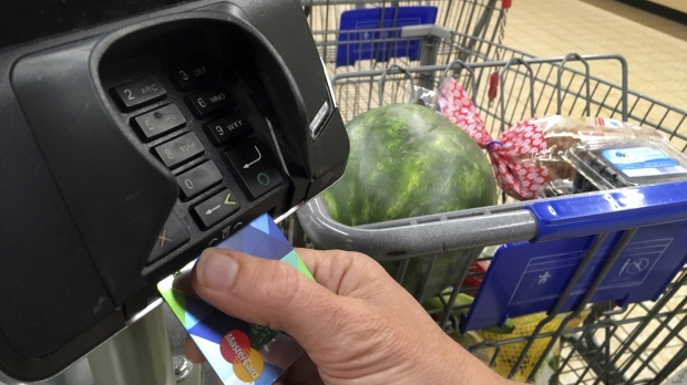 A customer buys groceries with a credit card