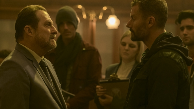"""(L to R in foreground) Stephen Root and James Badge Dale in a scene from """"The Empty Man"""""""