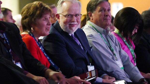 Pastor Ed Litton, center, of Saraland, Ala., attends the annual Southern Baptist Convention meeting Tuesday, June 15, 2021