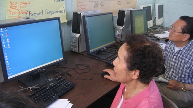 Seniors looking at computer screens
